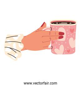 female hand holds cup of coffee