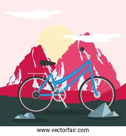 blue bike in front red mountains