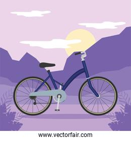 blue bike in front of purple mountains