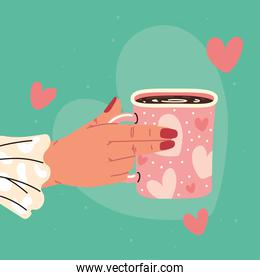 hand and cup with hearts