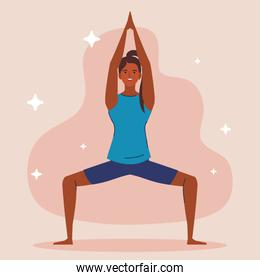 young woman afro practicing yoga