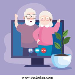 Grandfather and grandmother on computer in video call