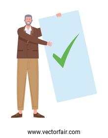 man with voting card