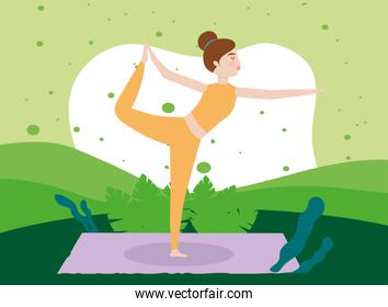 woman practices standing yoga