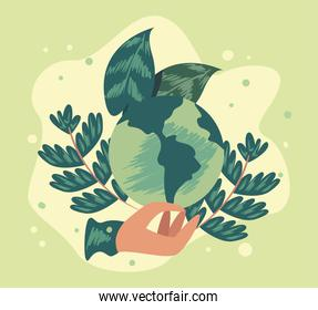 Hand holding eco earth with leaves
